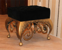Padded stool with shod legs