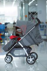 Baby carriage of gray color