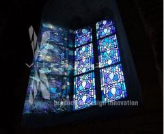The stained-glass window is blue