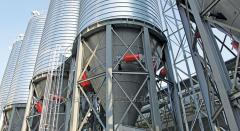 Steel silo with conical bottom for storing meal,