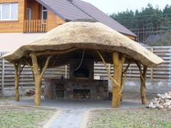 Construction of wooden arbors with a reed roof